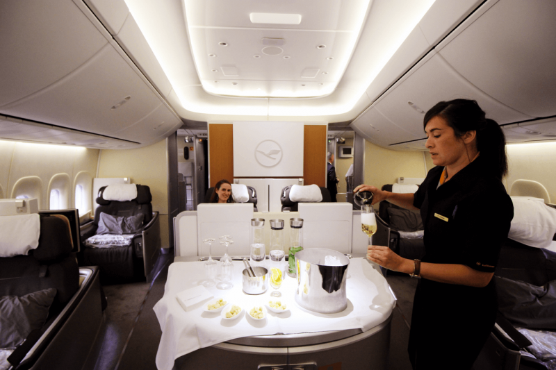 Lufthansa First Class Cabin Luxury Travel World Adventurers Flight Review Trip Report Champagne Boeing