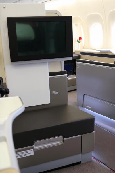 Lufthansa first class cabin, luxury travel world travel adventurers flight review trip report champagne Boeing 747-8 premium cabin luxury airlines