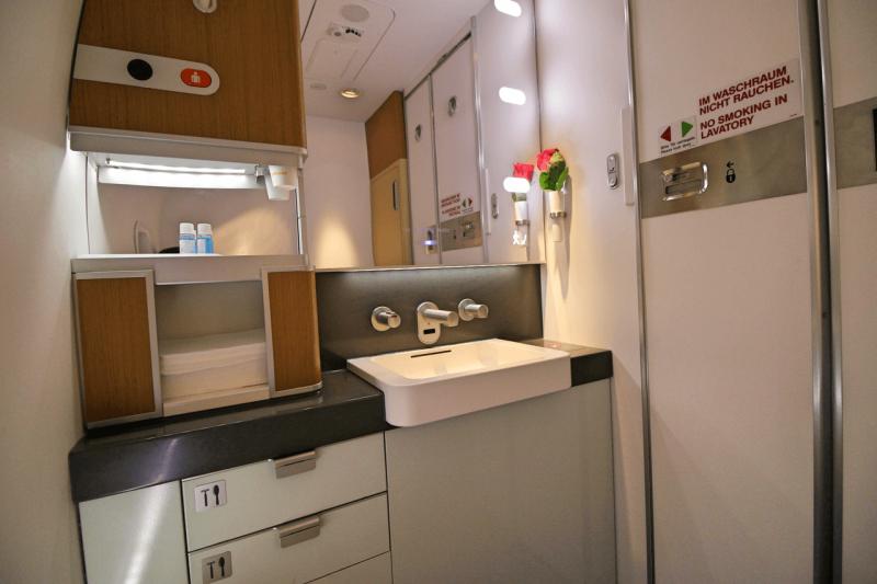 Lufthansa first class cabin, luxury travel world travel adventurers flight review trip report champagne Boeing 747-8 premium cabin luxury airlines Bathroom