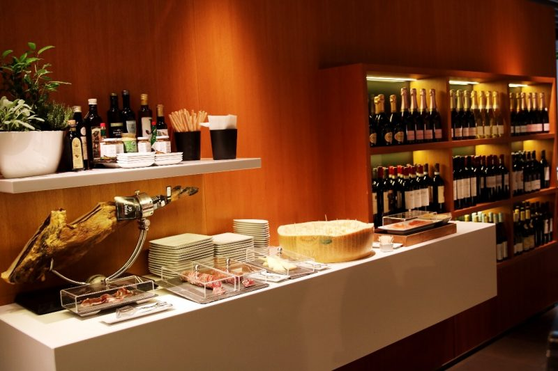 lufthansa frankfurt first class lounge luxury travel world travel adventurers WorldTravelAdventurers travel like a millionaire lounge review Germany travel blog Wine cheese prosciutto